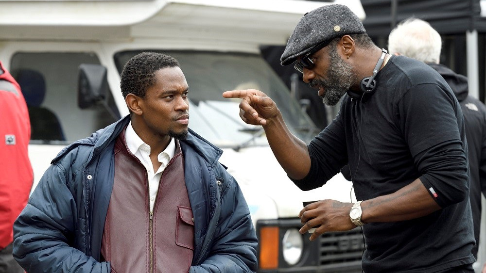 Idris Elba and Aml Ameen on set
