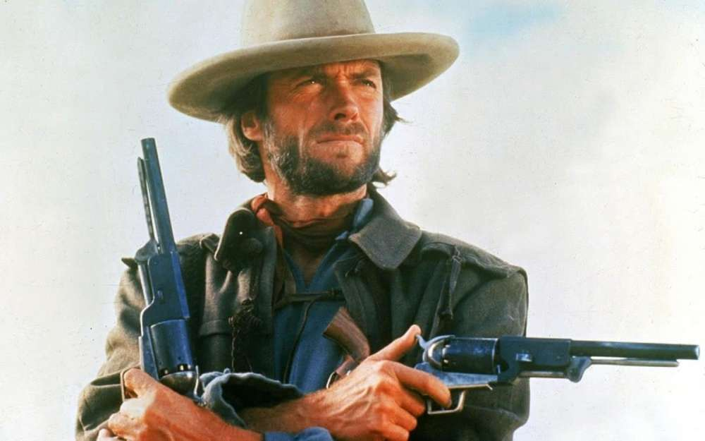 Clint Eastwood with iconic western revolvers