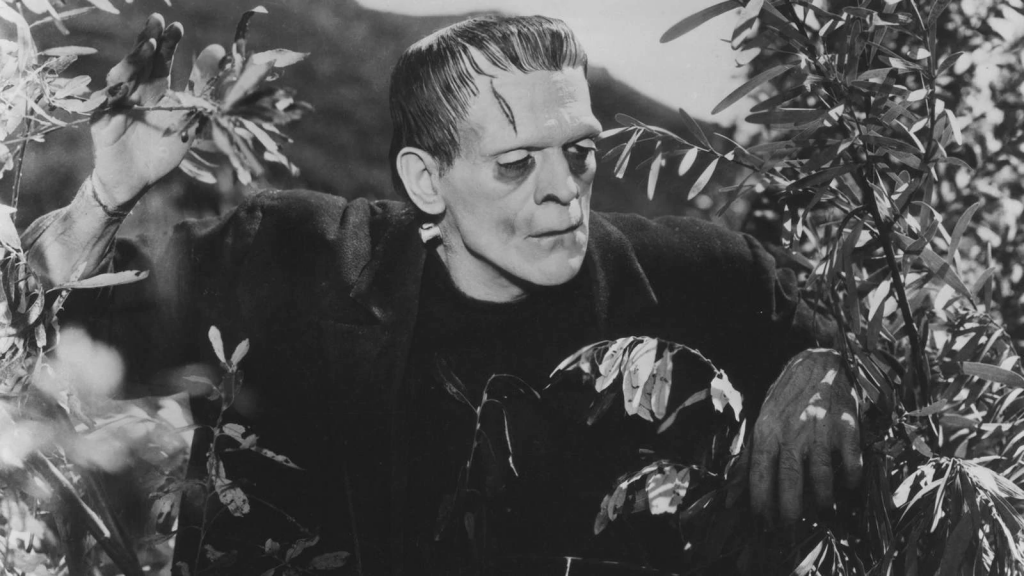Frankenstein's Monster prowling through the woods in Frankenstein (1931) [Source: Movie Monster Wiki - Fandom]