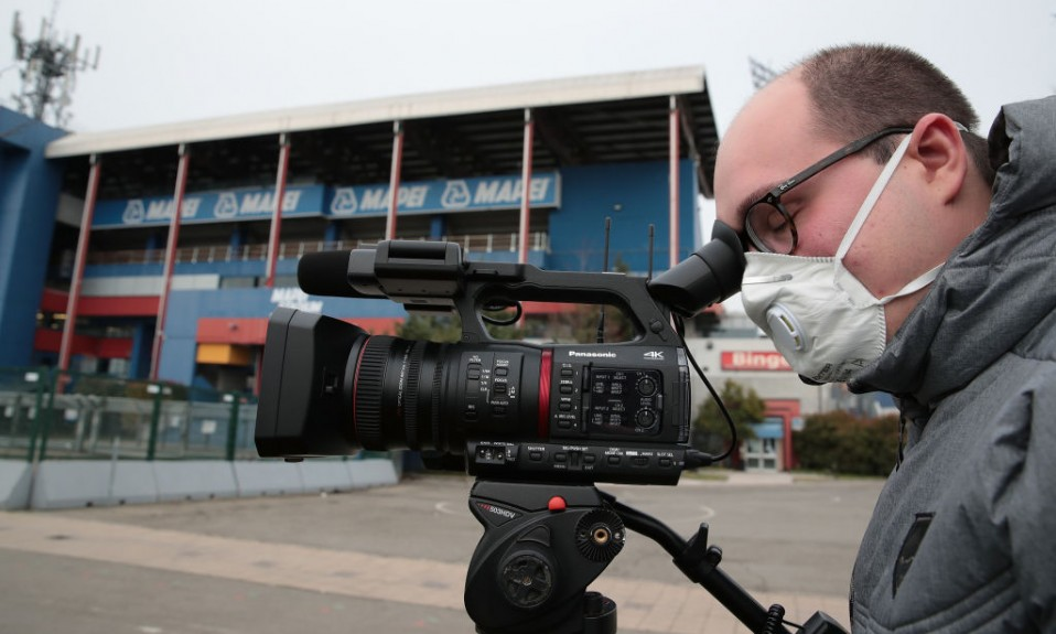 Camera operator wearing face mask