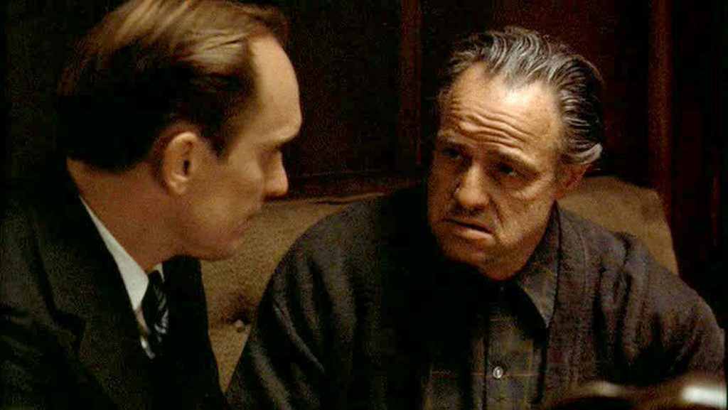 Robert Duvall as Tom Hagen and  Marlon Brando as Vito Corleone