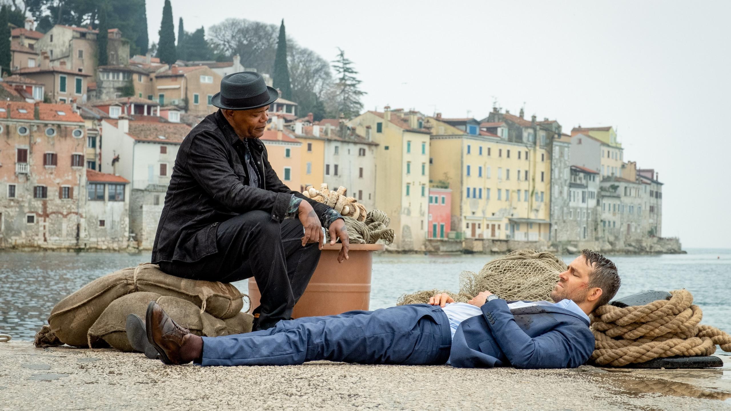 Samuel L. Jackson as Darius Kincaid and Ryan Reynolds as Michael Bryce in The Hitman's Wife's Bodyguard // Credit: Millennium Media