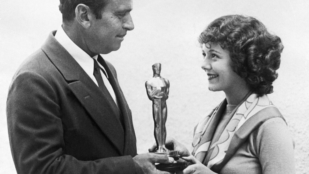 Douglas Fairbanks giving Janet Gaynor the first Oscar for Best Actress [Source: New York Times]
